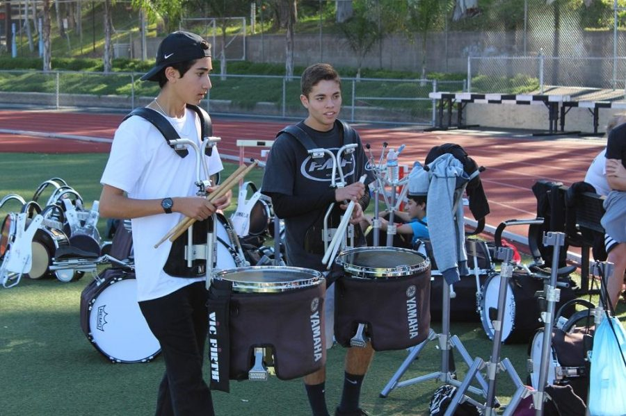 Drumline+begins+moving+their+equipment+after+practice%2C+getting+ready+to+load+it+back+on+the+truck+for+their+performance+the+next+day.