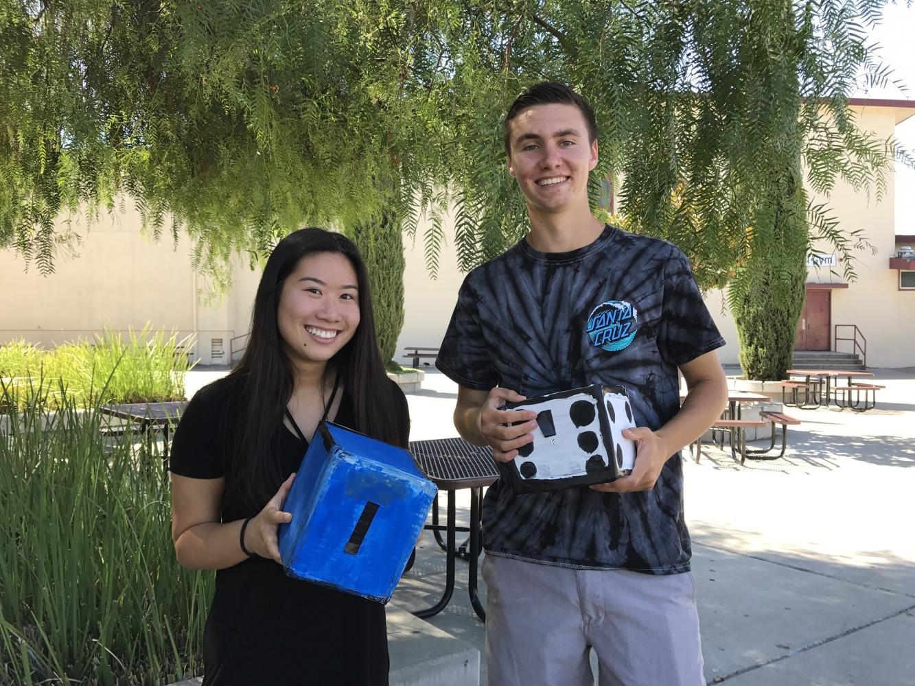 Andrew McGinty ('18) and Allison O'Yang ('18) show off their newly made cardboard cameras