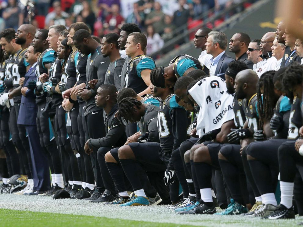Jaguars players kneel during the national anthem before a game against the Ravens on Sunday September 24th, 2017 at Wembley Stadium in London