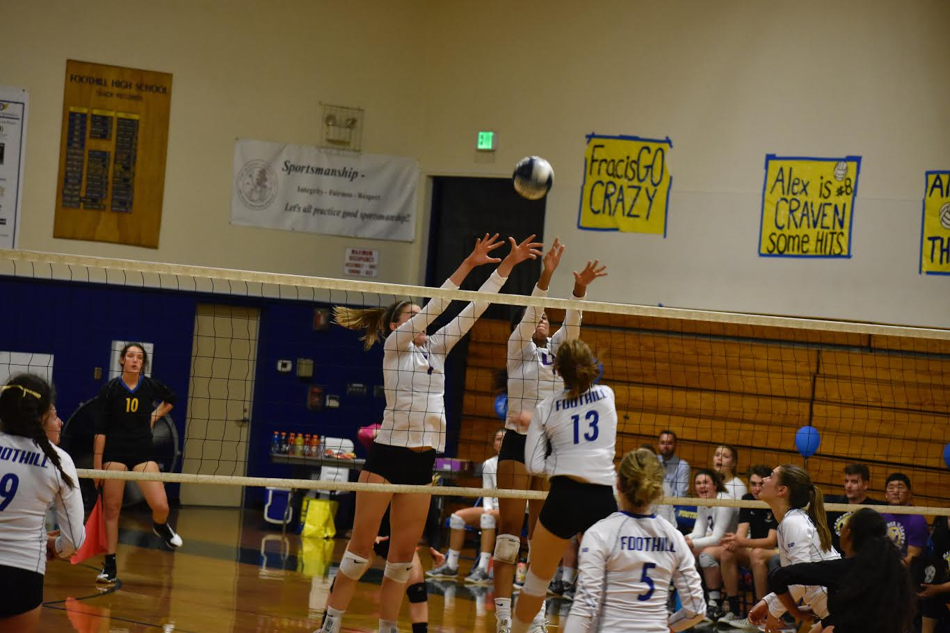 Captains Mahlia Jackson ('19) and Sarah Rieble ('19)  blocking Foothill's hit in last week's rivalry game where the Dons beat the Falcons in four sets.