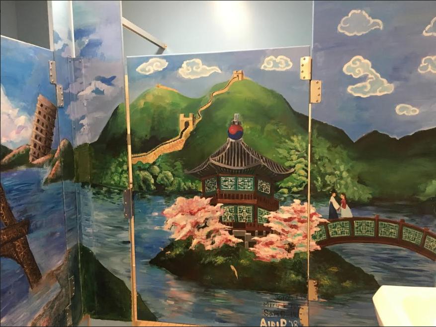 Airi Pan 18 has been working hard to restore the peeling mural in the girls bathroom.