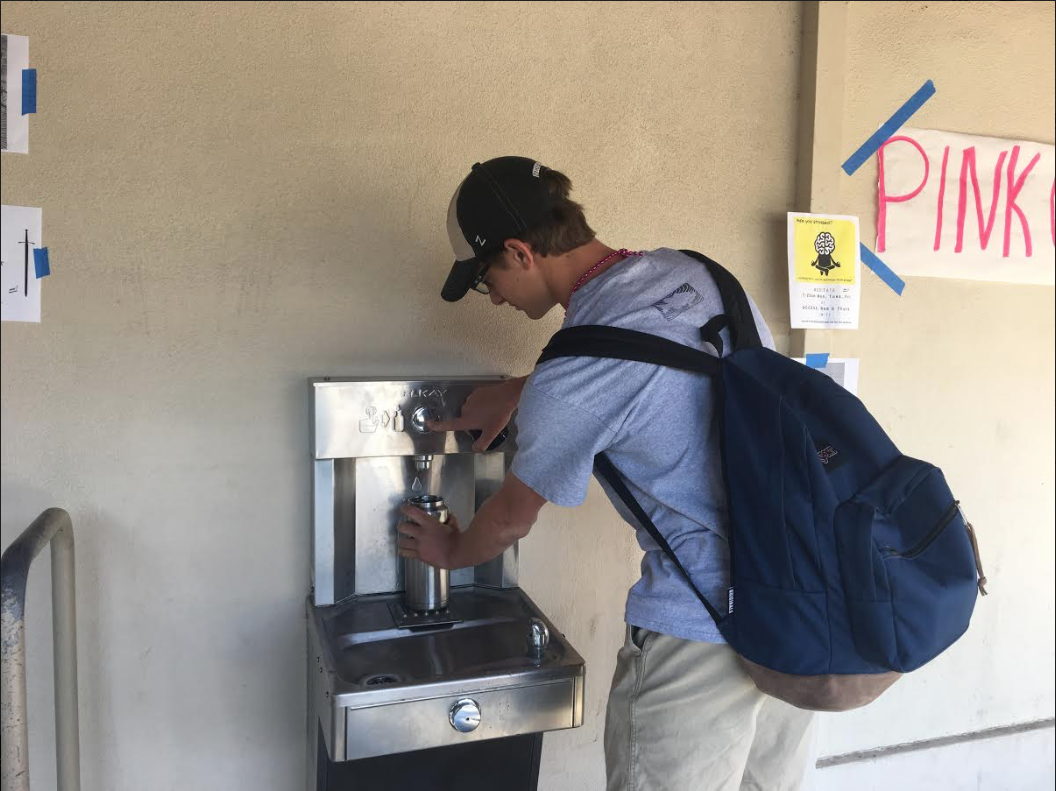Michael Cassetti ('19) fills up his Yeti water bottle at one of the hydration stations here on campus.