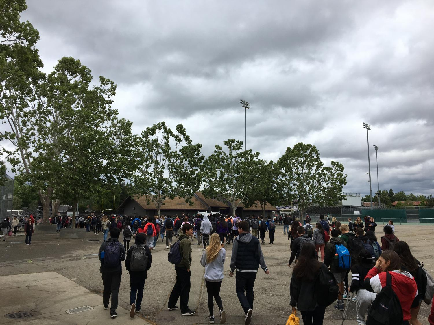 Students were evacuated to the field after the fire alarm was pulled during lunch.
