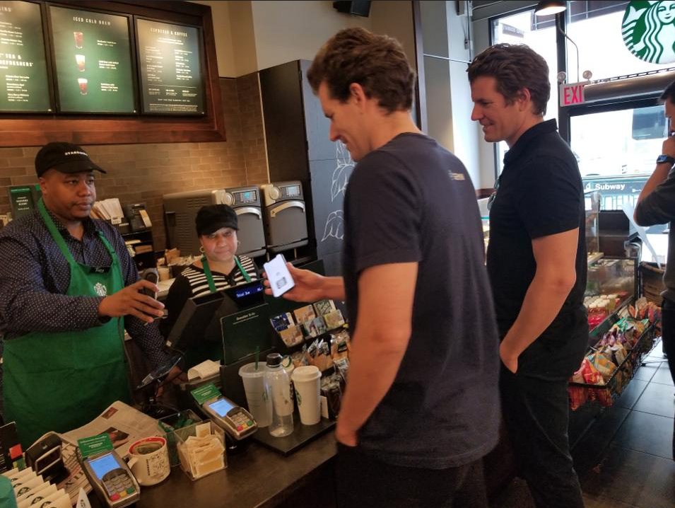 Winklevoss twins use cryptocurrency to pay for Starbucks.