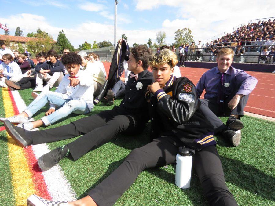 DJ Miranda, junior, poses for the camera with his fellow football fellas.