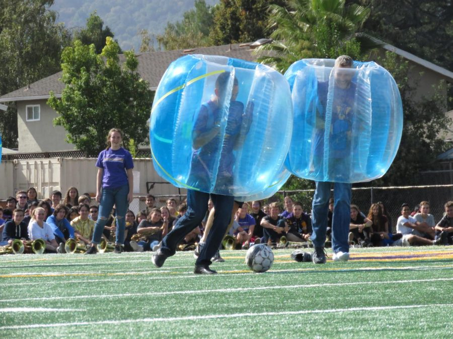 The teachers battle head-to-head in a game of bubble soccer.