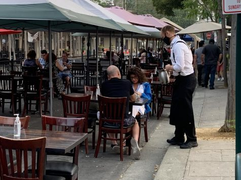 Despite Covid-19 and poor air quality, many families opt to dine in the tables set outside downtown restaurants. While eating, the diners do not wear masks, but restaurant staff try to stay safe by serving while wearing masks.