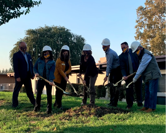The board trustees, Mr. Butterfield, and Dr. Haglund mark the first step of the construction process by posing with their shovels at the location where new buildings will be placed. While the board members are not actually shoveling, this picture represents the beginning of major upgrades to Amador Valley High School.