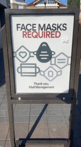 Most places of business require customers to wear masks to protect themselves and those working. This sign can be found at the Livermore Outlets, but similar signs can be found at other businesses.