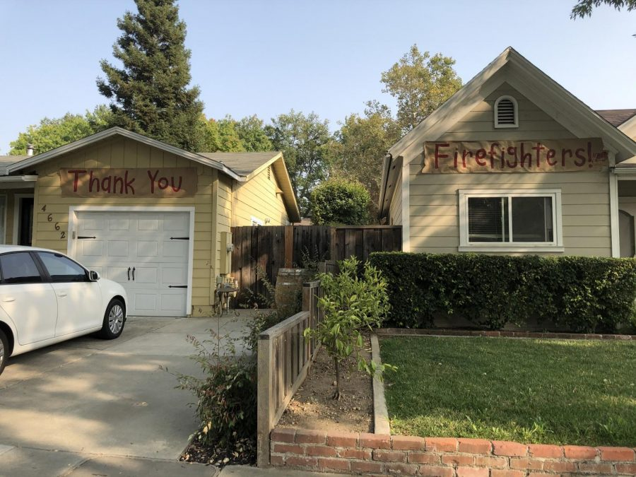 Houses put up banners to communicate their thanks for firefighters' work during trying times.