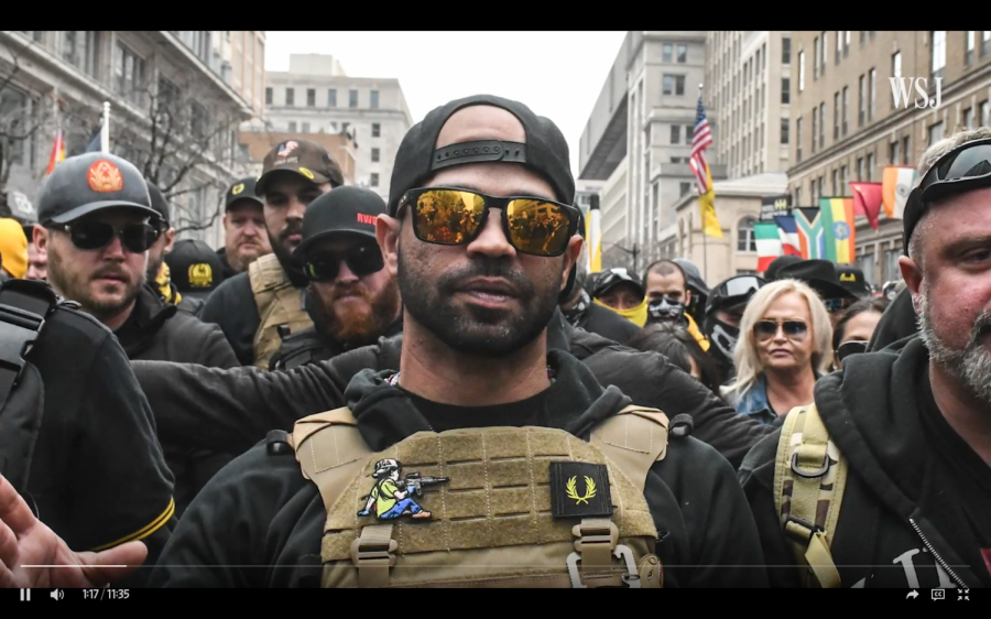 Enrique Tarrio, leader of the Proud Boys, guides the rest of his group members through a protest.