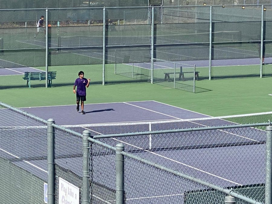 Sunny Mukherjee (21), Varsity Singles Player, takes a break from his efforts in his matches against Dublin.