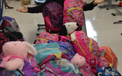 Janet Tarsi displays the backpacks for Chemo Bags of Hope in her classroom.