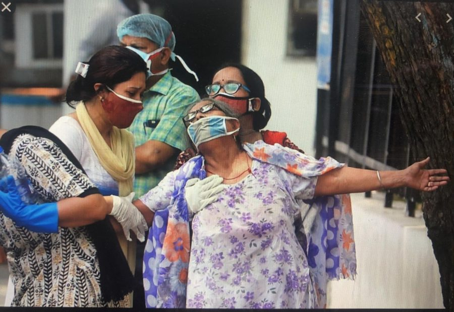 A woman is helped to walk, as she struggles with the fight against the Covid virus. Originally posted: AlJazeera.
