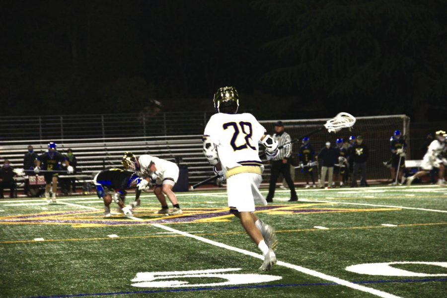#28 Max Quarneri ('23) dash in at the start of a play.