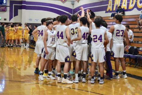 The whole team huddling up before the game.