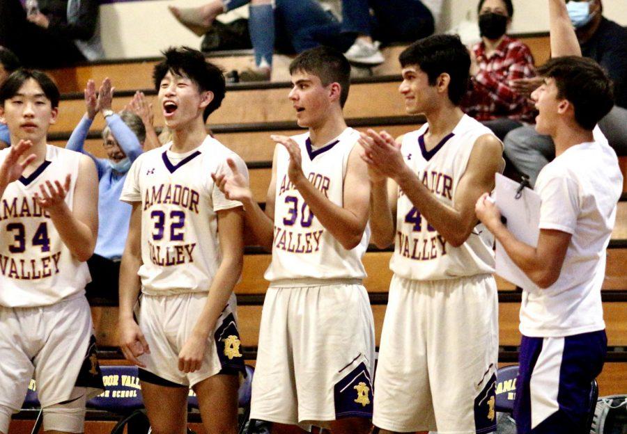 Jesse Huang (23), Jason Ooi (23), Abe Tabatabaian (22), Yash Maheshwaran (21) and Trevor Cheng (21) cheer on their teammates on the court.