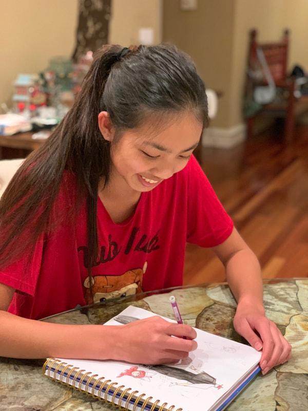 Kira Nguyen (23) teaches a drawing tutorial to senior citizens.