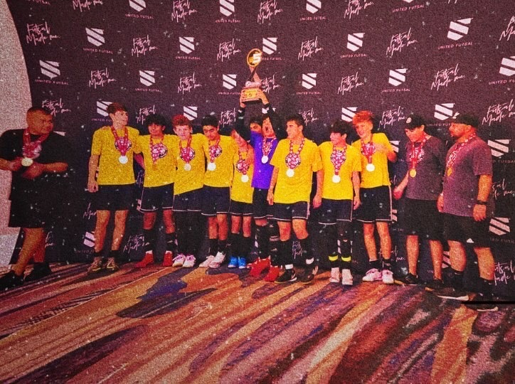 The Ballistic United Futsal Club lifts the trophy at the tournament after going unbeaten in a dominant display.