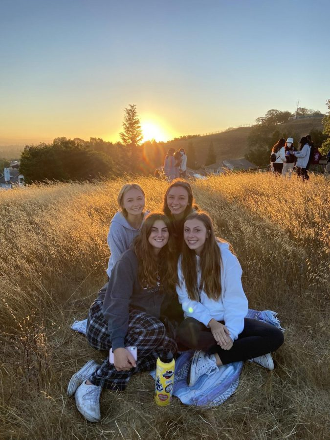 Seniors Sarah Carter, Imogen Rogers, Ella Hodges, and Hannah Rohr enjoyed a picture perfect moment together in front of the sunrise.