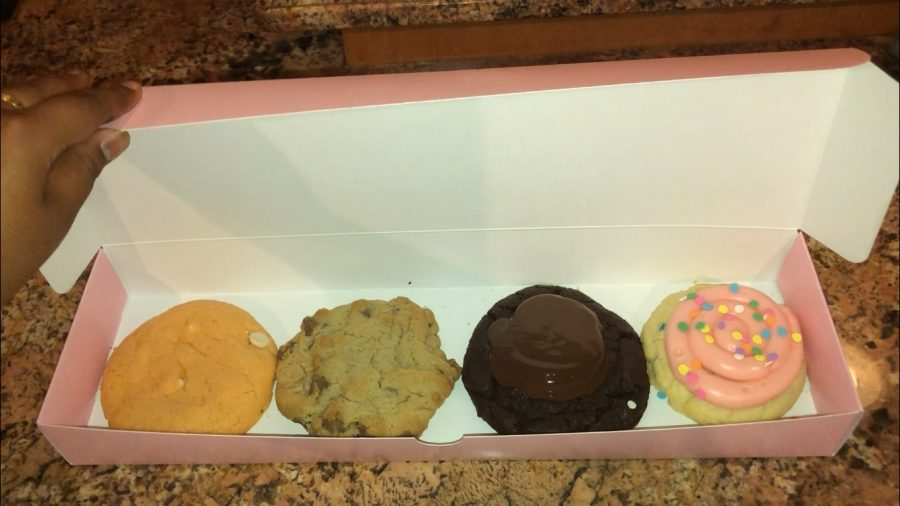 Crumbl Cookies are easily transportable in their pink box.