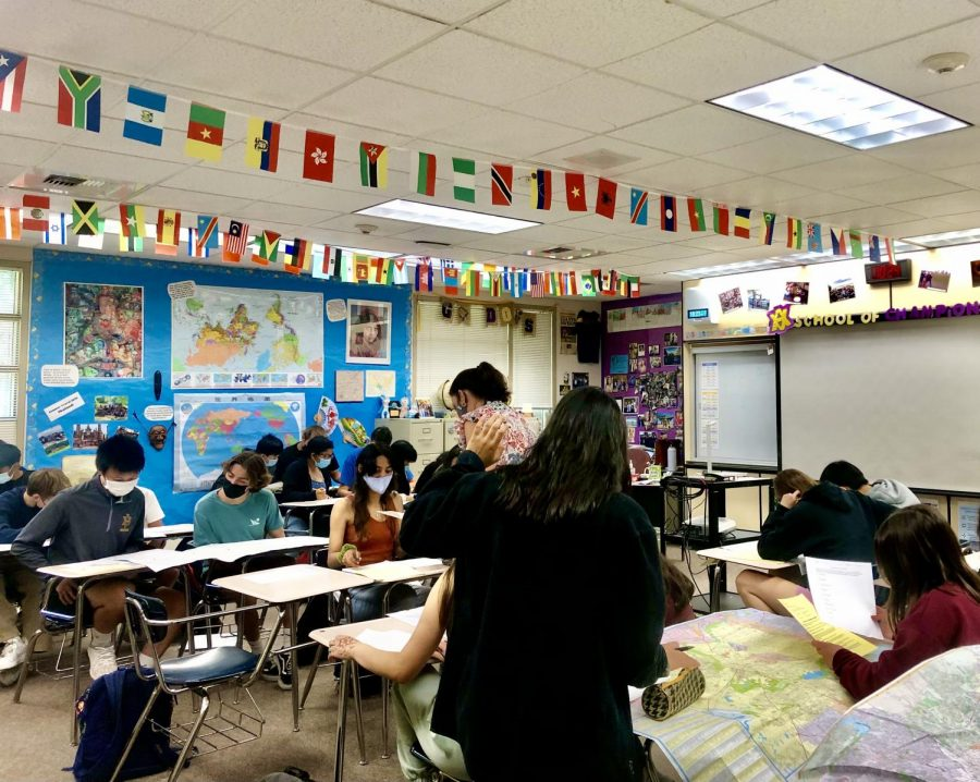 Jennifer Zuanich, AP Human Geography teacher, leads the class to read and understand core learnings.