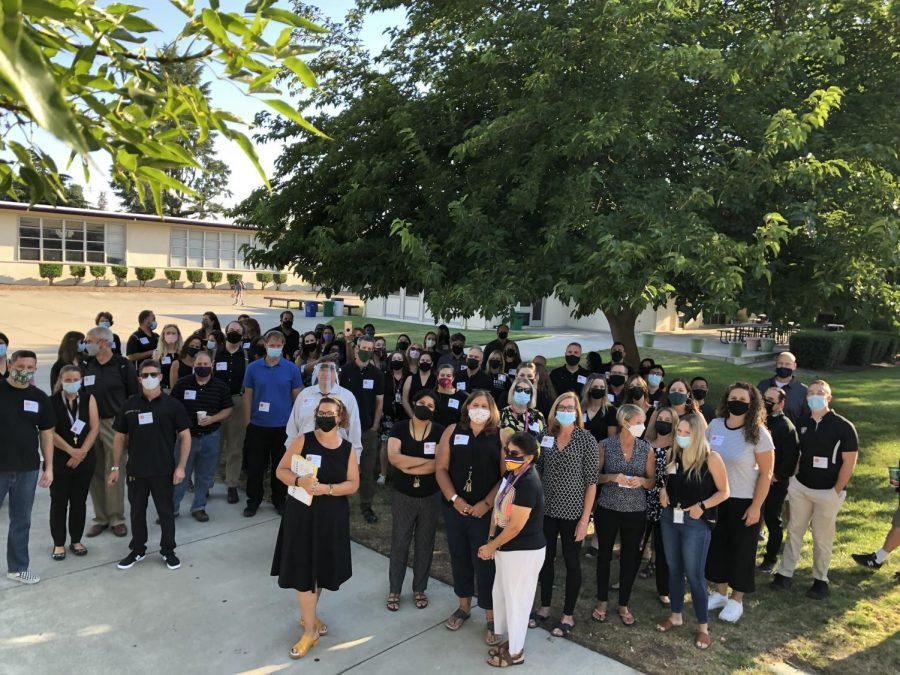 Teachers, wearing black and stickers, greeted and showed their support for Amador Valley students as they show up for the first day of school.