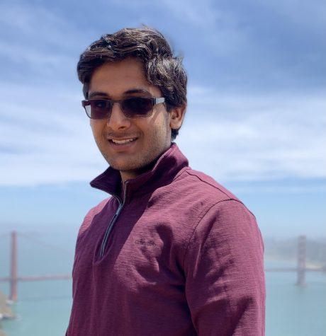 Gyan Bhambhani (23) smiles at the camera.