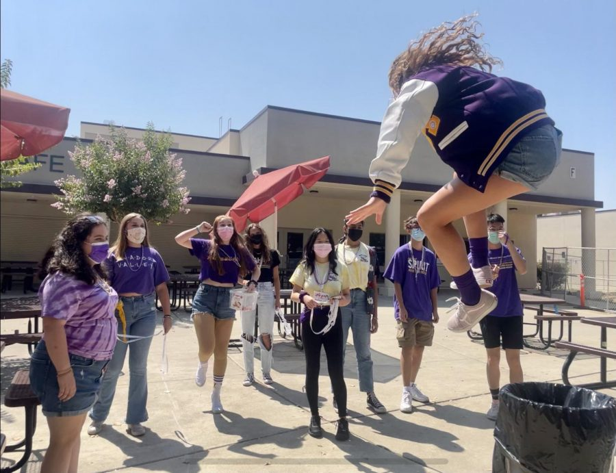 Hannah Walder ('22) hypes the leadership group up before going into the classrooms by playing music and jumping around.