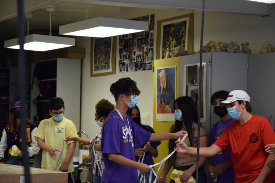 As the leadership kids happily go into the rooms they hand the students Amador Lanyards in preparation for the home game.
