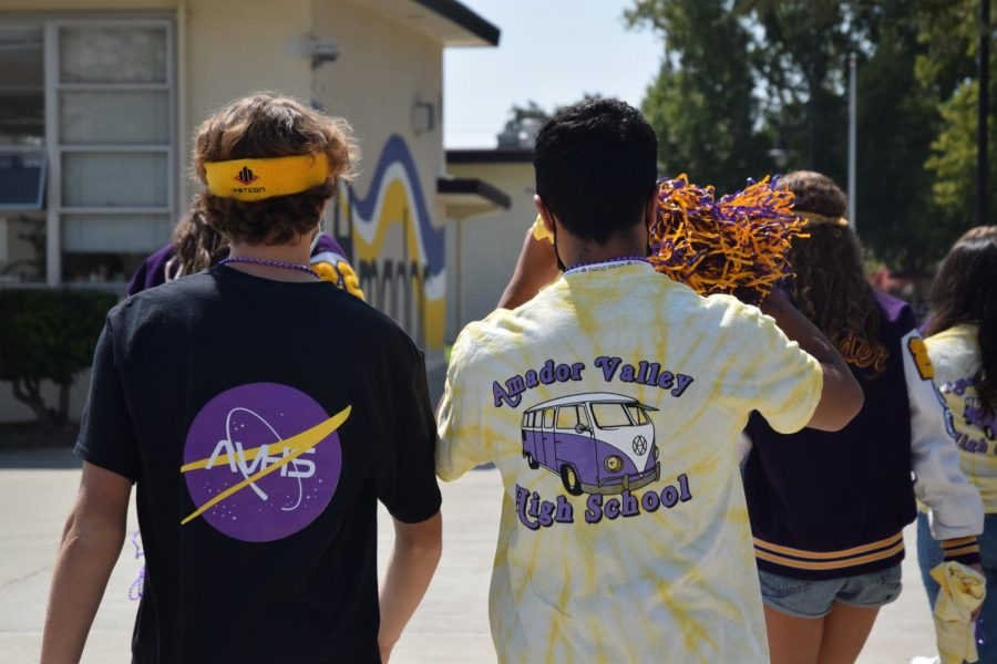 The group is covered in Amador shirts, colors, and accessories, ready to tell everybody about the football game against Bear Creek.