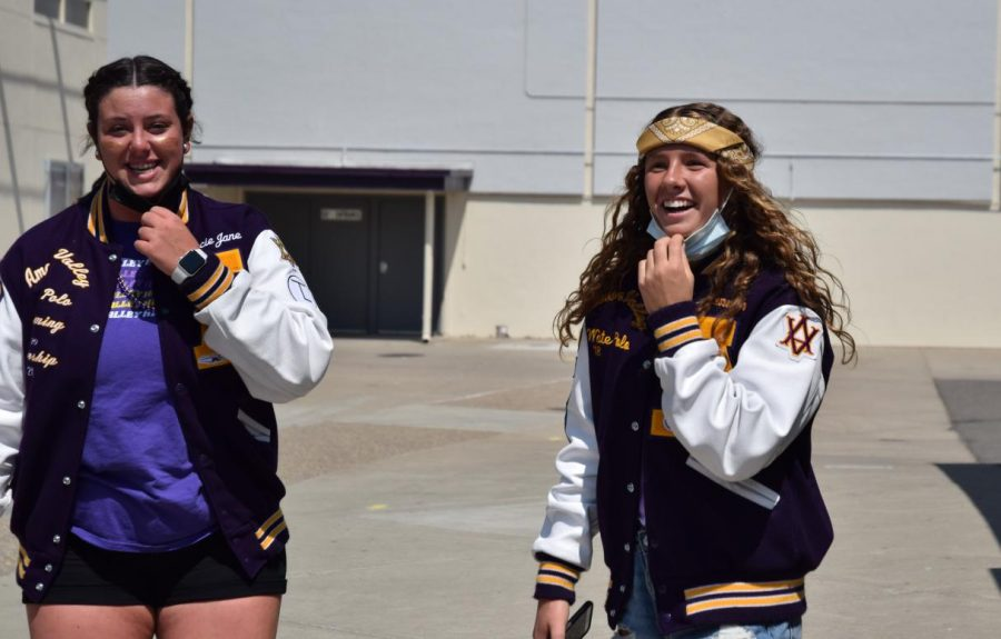 Hannah Walder ('22) and Gracie Quinn ('22) take a quick break and deep breath before they head into the next room to hype up the students for the big game.
