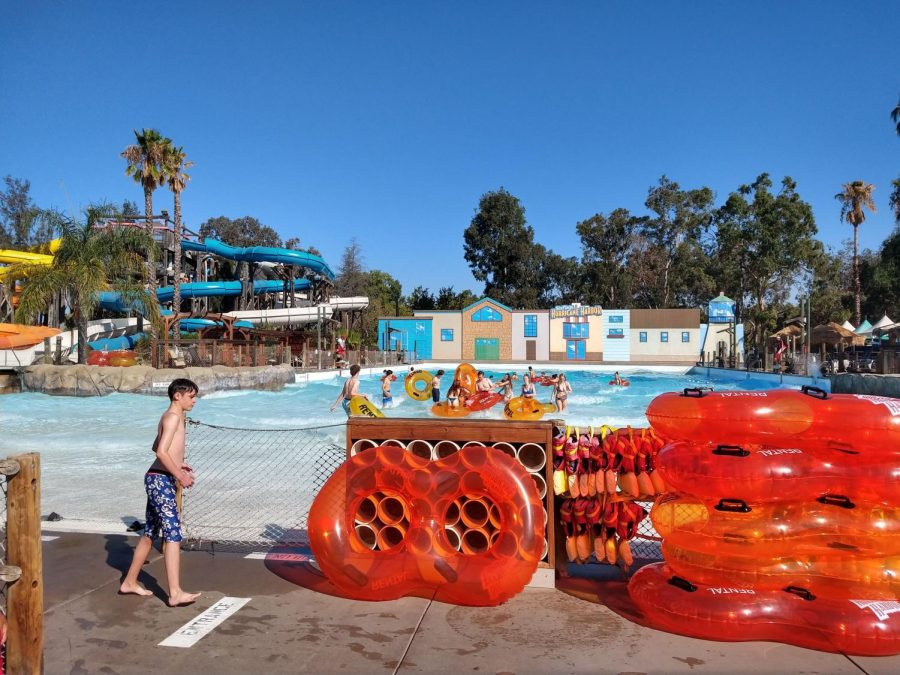 At the Breaker Beach Wave Pool, students challenge the powerful artificial waves in a pool on swimming floats.
