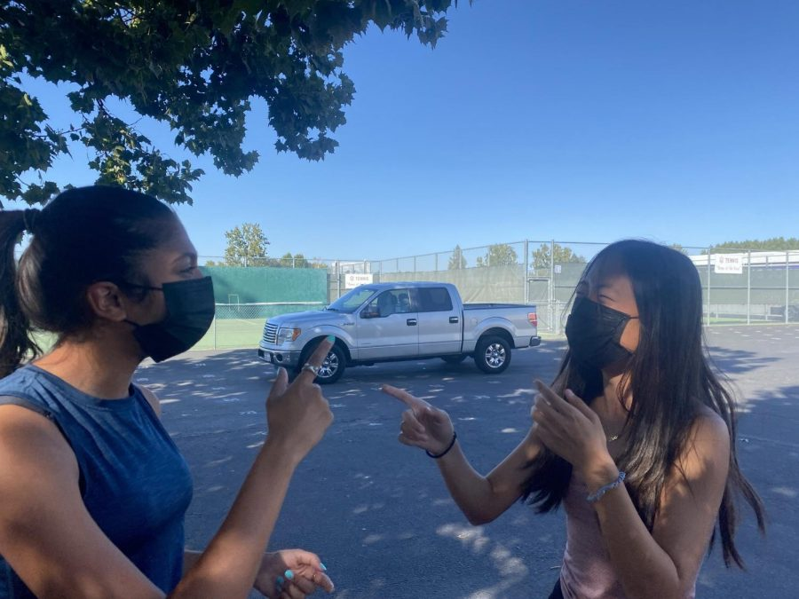 Lois Hong (22) and Juhi Goyal (24) laugh together after a long day at school. This year students have banded together and expanded their social horizons.
