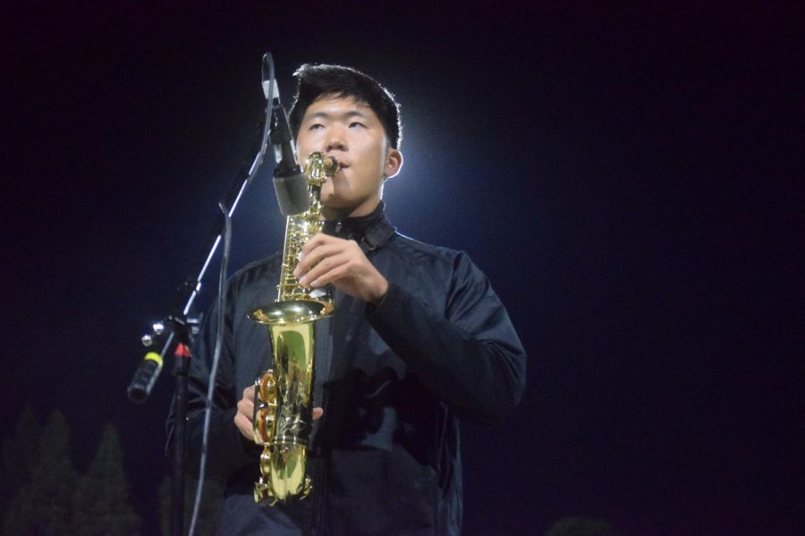 Ian Hwang (22), part of Amador Marching Band performs at half time, ready to blow the field away with their harmonious sound and skilled colorguard.
